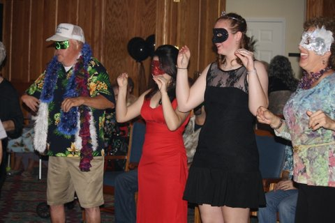 Students dance with the River Oak's residents
