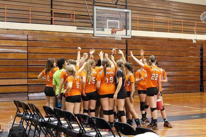 The+LCHS+girl%27s+volleyball+team+huddles+together+after+their+first+victory+of+the+season.