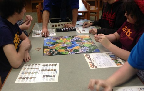 Mr. Johnston joins in on a game with the Strategy Club.