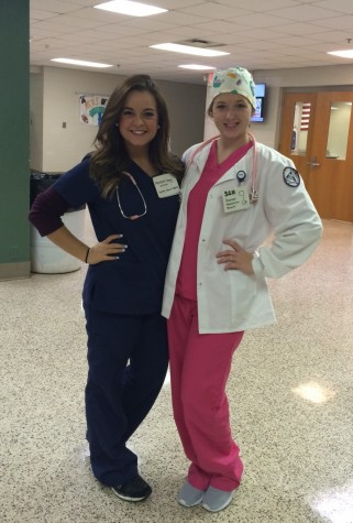 Taylor Henry (12) and Danielle Bowman (12) as Meredith Grey and Addison Shepherd from Grey's Anatomy.