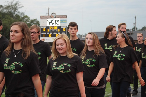 The Singers walk onto the field to sing the National Anthem.