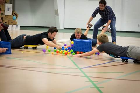 Andy Thornton (12), Eric Hall (11), Trevor Good (11), and Philip Sparks (10) play Hungry Hungry Hippos.