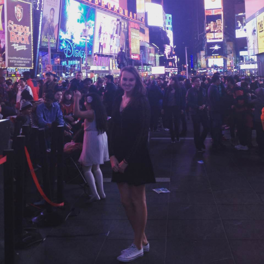 Stacy Horton (11) poses in Times Square.