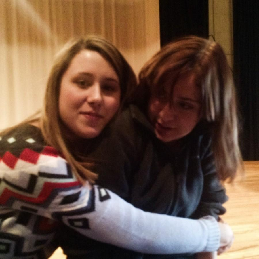 Ashton Hall and Emilee Salyers (10)  hang out before theatre class in the auditorium.