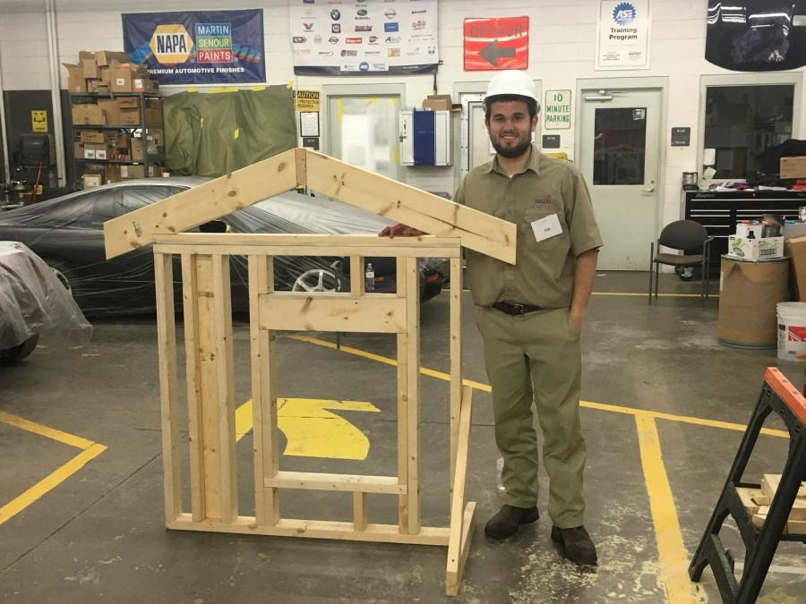 Andrew Ingram (12)  poses after winning the Regional Skills USA Carpentry competition.