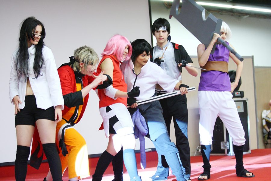 A+group+of+enthusiasts+wear+costumes+of+their+favorite+characters.+
