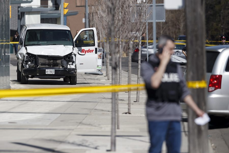 TORONTO%2C+ON+-+APRIL+23%3A++Police+inspect+a+van+suspected+of+being+involved+in+a+collision+injuring+at+least+eight+people+at+Yonge+St.+and+Finch+Ave.+on+April+23%2C+2018+in+Toronto%2C+Canada.+A+suspect+is+in+custody+after+a+white+van+collided+with+multiple+pedestrians.+%28Photo+by+Cole+Burston%2FGetty+Images%29